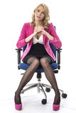 Business Woman Thinking Wearing Pink and Sitting in an office Chair Royalty Free Stock Photos