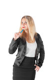 Business woman thinks holding the blue pen Royalty Free Stock Image