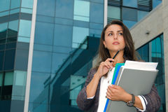 Business woman thoughtfully looks aside Stock Photos