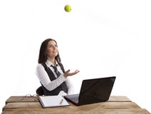 Business woman throwing apple Royalty Free Stock Photo