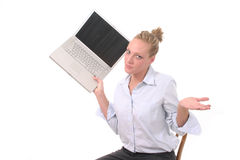 Business Woman Throwing Laptop 3. Gesturing and possibly frustrated young woman seriously considering throwing her laptop computer Royalty Free Stock Image