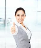 Business woman thumb up gesture, in modern office Royalty Free Stock Images