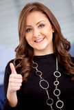 Business woman with thumbs-up Stock Images