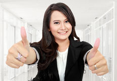 Business woman thumbs up Stock Image
