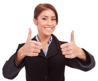 Business woman with thumbs up gesture Stock Photo