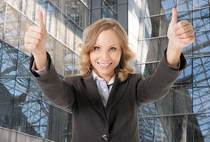 Business woman thumbs up smiling Royalty Free Stock Photos