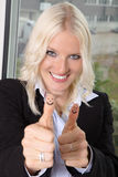 Business woman thumps up Stock Images