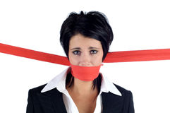 Business woman tied with red tape Royalty Free Stock Photography