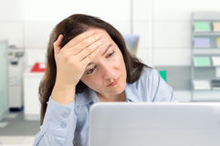Business woman tired at the office Royalty Free Stock Photo