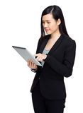 Business woman touch the tablet Royalty Free Stock Image