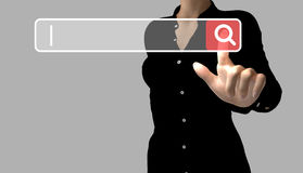 A business woman touches a search button Royalty Free Stock Photos