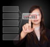 Business woman touching button Stock Photo