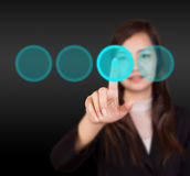 Business woman touching button Stock Photography