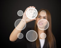 Business woman touching button Stock Photos