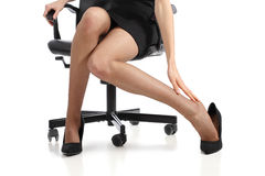 Business woman touching feet with her hand. Isolated on a white background Stock Image
