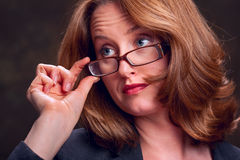 Business woman touching glasses Royalty Free Stock Photography