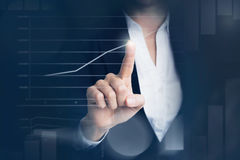 Business woman touching graph royalty free stock photo