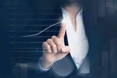 Business woman touching graph Royalty Free Stock Photo