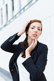 Business woman touching her face Royalty Free Stock Photo