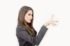 Business woman touching an imaginary screen Royalty Free Stock Images