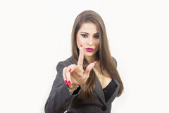 Business woman touching an imaginary screen Royalty Free Stock Photography