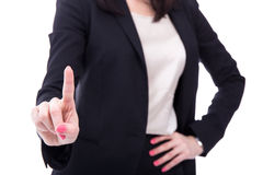 Business woman touching imaginary screen or pressing button with Stock Photography