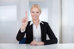 Business woman touching the screen with her finger Royalty Free Stock Photos