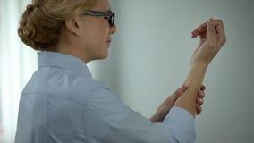 Business woman touching wrist, suffering rheumatoid arthritis, health care royalty free stock images