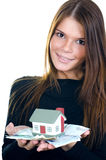 Business woman with the toy house and banknotes Stock Photo