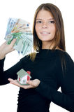 Business woman with the toy house and banknotes Royalty Free Stock Photos