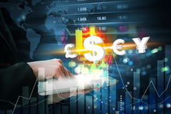 Business woman are trading stock market with currency symbol by Royalty Free Stock Photo