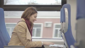 Business woman on the train running on the tablet. Raw video stock video footage
