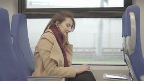 Business woman on the train running on the tablet. Raw video stock footage