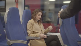 Business woman on train running on tablet. Business woman on the train running on tablet, raw video stock video