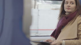 Business woman on train running on tablet. Business woman on the train running on tablet, raw video stock video footage
