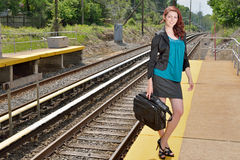 Business woman at train station Stock Image