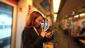 Business woman on the train station. Business woman are using her mobile on the train