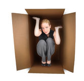 Business Woman Trapped in Box. A business woman is trapped in a small box with anxiety on a white background. Use it for a employment or pressure metaphor Stock Photography