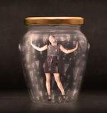 Business woman trapped in jar with exclamation marks concept Stock Photos