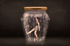 Business woman trapped in jar with exclamation marks concept. On bakcground Stock Photos