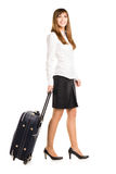 Business woman with travel bag isolated on white background.  Royalty Free Stock Image