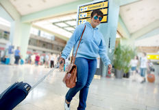 Business Woman Traveler Rushing Through the Airport Terminal to Stock Image