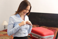 Business woman traveler undressing in a hotel room Stock Image