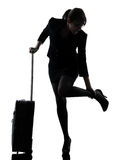 Business woman traveling massaging feet silhouette Stock Photos