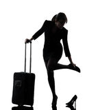 Business woman traveling massaging feet silhouette Stock Photography