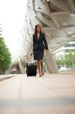 Business woman traveling with suitcase Royalty Free Stock Image