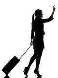 Business woman  traveling walking   hailing silhouette Stock Images