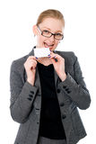 Business woman tries on a tooth credit card Stock Image