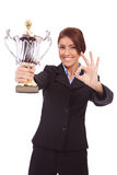 Business woman with trophy make ok gesture Stock Photos