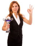 Business woman with trophy make ok gesture. Business woman winning a trophy isolated on white background royalty free stock photography